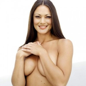Young Nude Woman Covering Her Breasts with Her Arms