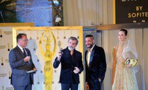 Premiazione allo stilista Michele Miglionico.1